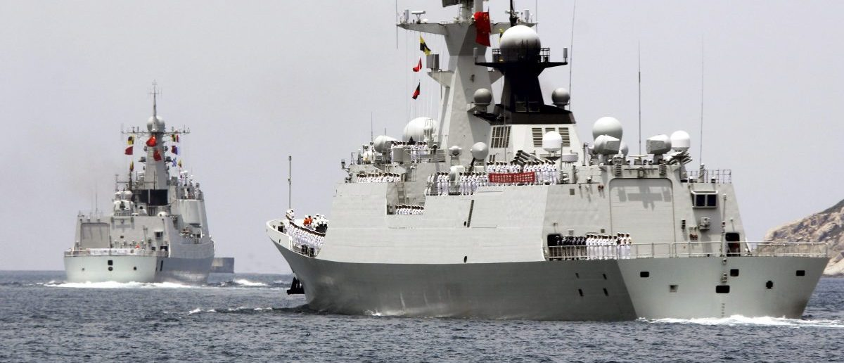Chinese naval destroyer Haikou (L) and missile frigate Yueyang depart for the Rim of the Pacific exercise (RIMPAC), at a military port in Sanya, Hainan province June 9, 2014. China on Monday confirmed that it will participate for the first time in a major U.S.-hosted naval drill this month, sending four ships including a destroyer and frigate, even as deep military distrust persists between the two countries. Picture taken June 9, 2014. REUTERS/Stringer