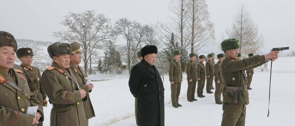 North Korean leader Kim Jong Un (C) stands in the snow as he inspects KPA Unit 1313. Photo released by North Korea's Korean Central News Agency (KCNA) in Pyongyang December 5, 2014. REUTERS/KCNA