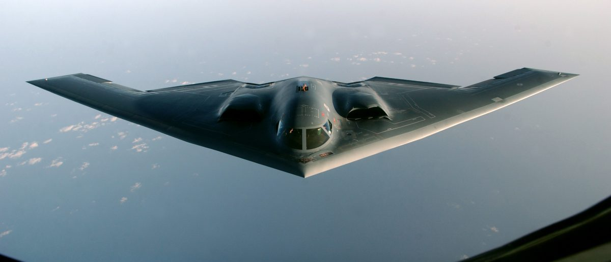 "A B-2 Spirit proceeds to an undisclosed location after flying a mission over Iraq, March 27, 2003. A U.S. B-2 bomber on Friday dropped two earth-shattering 4,600-pound (2,086 kg) ""bunker-buster"" bombs on a downtown Baghdad communications tower, defense officials said. it was the first use of the big bombs in a week-long pounding of the Iraqi capital. U.S.-led jets and ships have used more than 5,000 bombs and missiles against Baghdad and across Iraq in a war to depose President Saddam Hussein. REUTERS/Cherie A. Thurlby/U.S. Air Force"