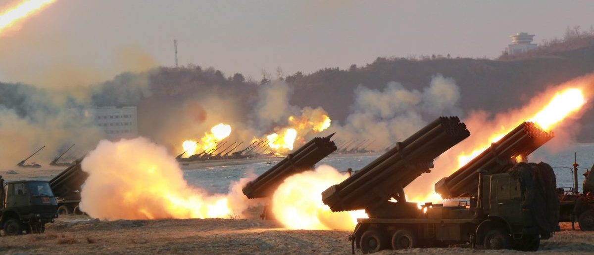 Multiple DPRK rocket launchers are seen being fired during a military drill at an unknown location, in this undated photo released by North Korea's Korean Central News Agency (KCNA) on March 25, 2016. REUTERS/KCNA