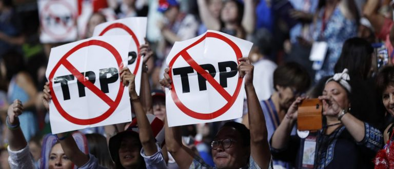 Delegates protesting against the Trans Pacific Partnership (TPP) trade agreement hold up signs during the first sesssion of the Democratic National Convention in Philadelphia, Pennsylvania, U.S. July 25, 2016. REUTERS/Mark Kauzlarich