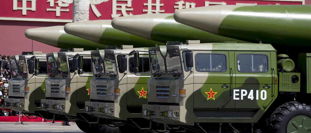 Military vehicles carrying missiles travel past Tiananmen Gate in Beijing Thursday Sept. 3, 2015. REUTERS/Andy Wong/Pool