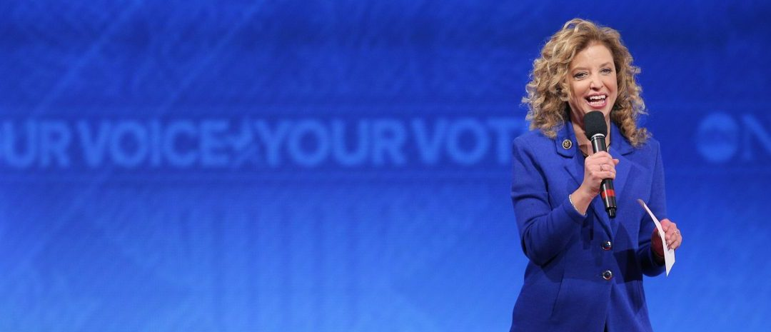 Democratic National Committee Chair and U.S. Rep. Debbie Wasserman Schultz speaks to the audience before the start of the Democratic presidential candidates debate at St. Anselm College in Manchester, New Hampshire December 19, 2015.  REUTERS/Brian Snyder