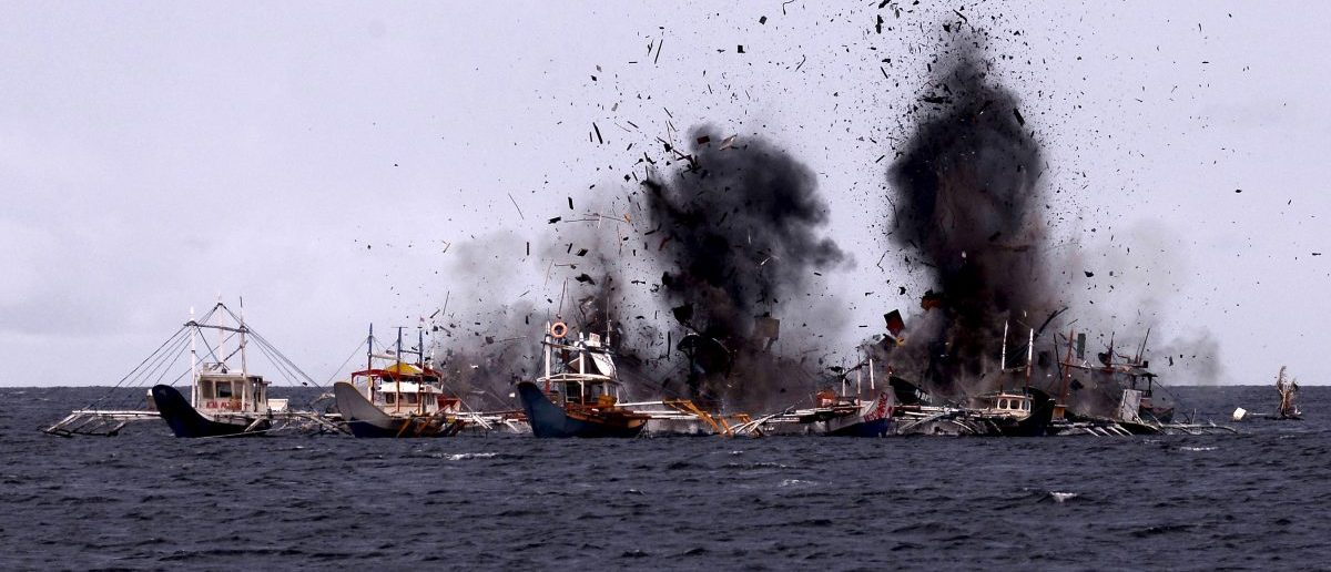 Foreign fishing boats seized for illegal fishing are blown up near Bitung, North Sulawesi, Indonesia February 22, 2016 in this photo taken by Antara Foto. The Ministry of Maritime Affairs and Fisheries, together with the Indonesian Navy, destroyed 30 foreign fishing vessels in different locations across the country, which were seized earlier for illegal fishing in Indonesian waters. REUTERS/Adwit B Pramono/Antara Foto