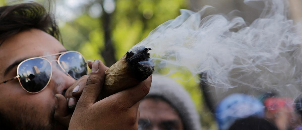 A man smokes marijuana during a rally for the legalization of marijuana in Mexico City, Mexico, May 7, 2016. REUTERS/Henry Romero