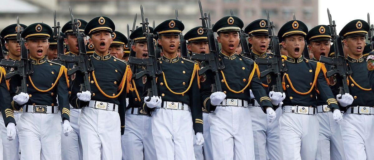 Taiwanese cadets march during a ceremony to mark the 92nd anniversary of the Whampoa Military Academy, in Kaohsiung, southern Taiwan June 16, 2016. REUTERS/Tyrone Siu - RTX2GHKT