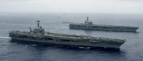 The Nimitz-class aircraft carriers USS John C. Stennis (CVN 74), and USS Ronald Reagan (CVN 76) (rear) conduct dual aircraft carrier strike group operations in the U.S. 7th Fleet area of operations in support of security and stability in the Indo-Asia-Pacific in Philippine Sea on June 18, 2016. Courtesy Jake Greenberg/U.S. Navy/Handout via REUTERS