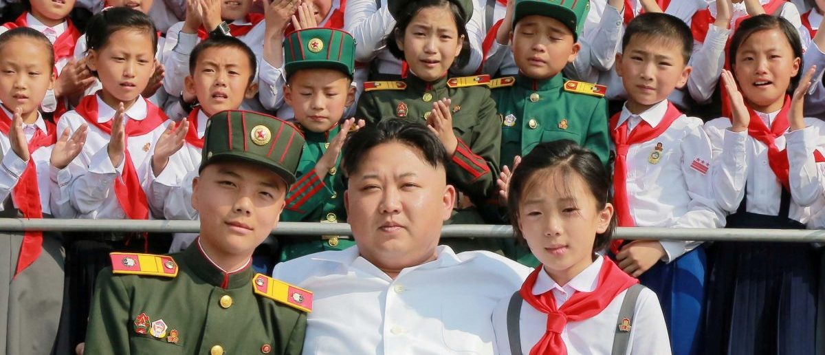 "Schoolchildren stand beside North Korean leader Kim Jong Un as he arrives to attend ""We Are the Happiest in the World"", a performance of schoolchildren to celebrate the 70th founding anniversary of the Korean Children's Union (KCU), in this undated photo released by North Korea's Korean Central News Agency (KCNA) in Pyongyang June 8, 2016. REUTERS/KCNA/File Photo"