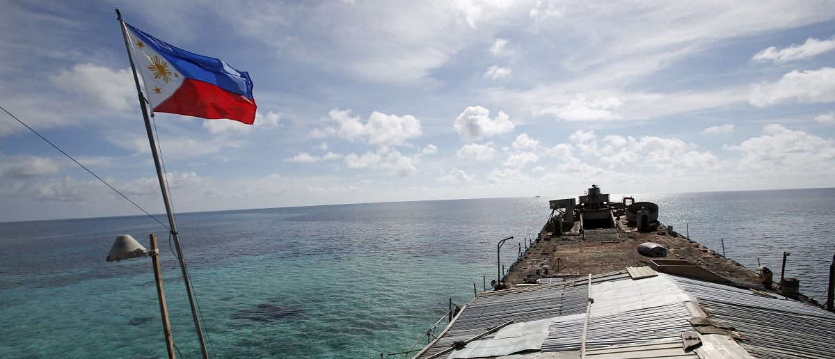A Philippine flag flutters from BRP Sierra Madre, a dilapidated Philippine Navy ship that has been aground since 1999 and became a Philippine military detachment on the disputed Second Thomas Shoal, part of the Spratly Islands, in the South China Sea March 29, 2014. REUTERS/Erik De Castro