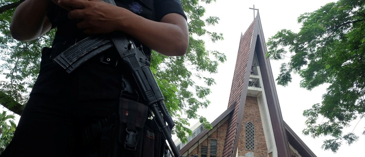 Police are seen outside Saint Joseph's Catholic Church after a suspected terror attack by a knife-wielding assailant on a priest during Sunday service in Medan, North Sumatra, Indonesia August 28, 2016 in this photo taken by Antara Foto. Picture taken August 28, 2016.Antara Foto/Irsan Mulyadi/ via REUTERS