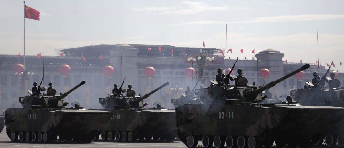 People's Liberation Army (PLA) amphibious assault vehicles rumble pass Tiananmen Square in a massive parade to mark the 60th anniversary of the founding of the People's Republic of China in Beijing October 1, 2009. REUTERS/Nir Elias