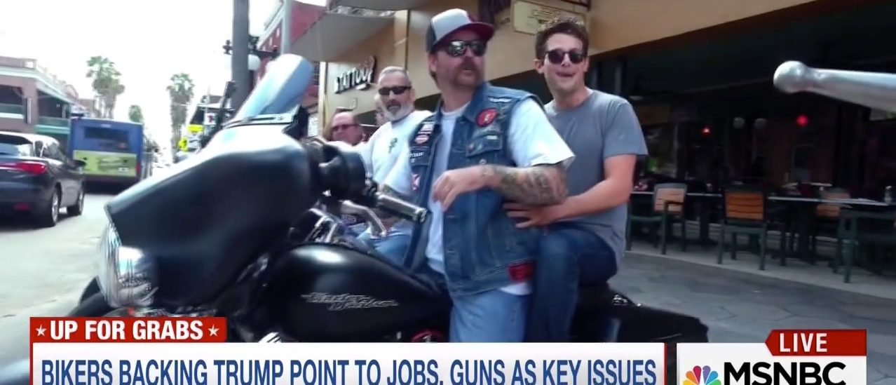 Jacob Soboroff rides on the back of a motorcycle (MSNBC)