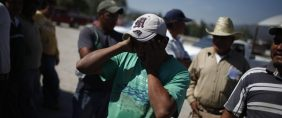 Man reacts as he talks about his life as an illegal alien in the U.S. at a market in the town of Ixmiquilpan