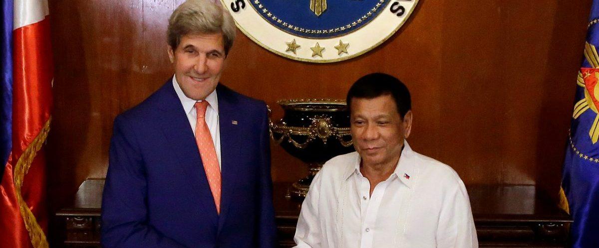Philippine President Rodrigo Duterte welcomes U.S. Secretary of State John Kerry during his visit at the Malacanang presidential palace in metro Manila