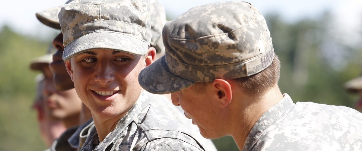 Griest and Haver chat as they wait to receive their ranger tabs at Ranger school graduation at Fort Benning in Columbus
