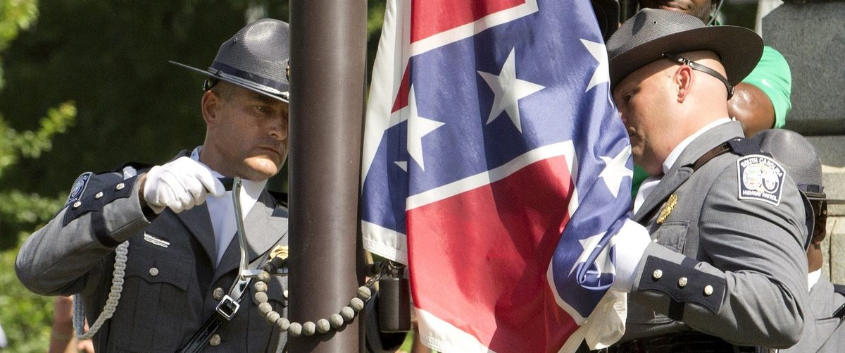 """The Confederate battle flag is permanently removed from the South Carolina statehouse grounds during a ceremony in Columbia, South Carolina July, 10, 2015. South Carolina removed the Confederate battle flag from the state capitol grounds on Friday to chants of """"USA, USA!,"""" after three weeks of emotional debate over the banner, a symbol of slavery and racism to many, but of Southern heritage and pride to others. REUTERS/Jason Miczek."""