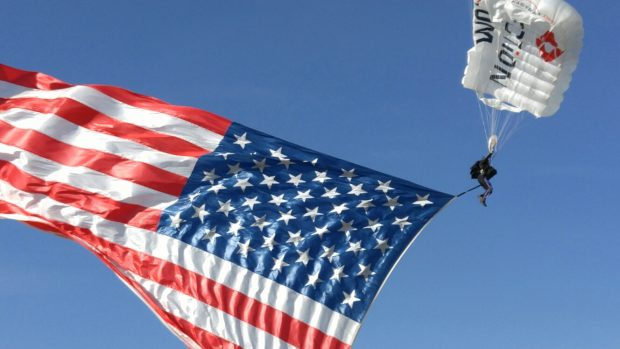 Skydiver Dan Paganini, Team Fastrax, jumps in American flag for ceremony. (Photo: Alex Quade)