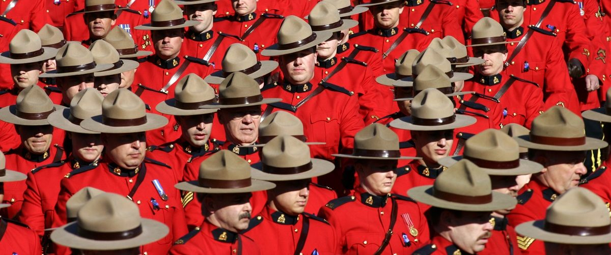 File photo of RCMP officers marching during a memorial in Edmonton