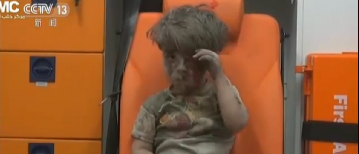 """Image of Omran from CCTV report """"Was It Staged? Was It Exaggerated? Video Suspected Of Being Fake? (CCTV screenshot)"""