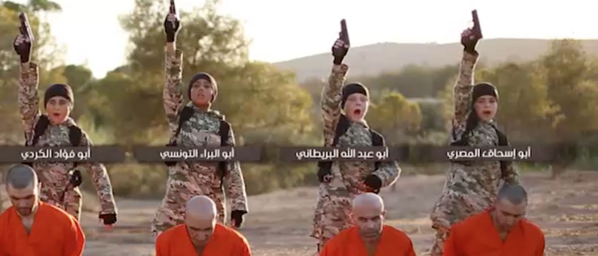 ISIS child executioners prepare to kill their captives. Source: Video Screenshot