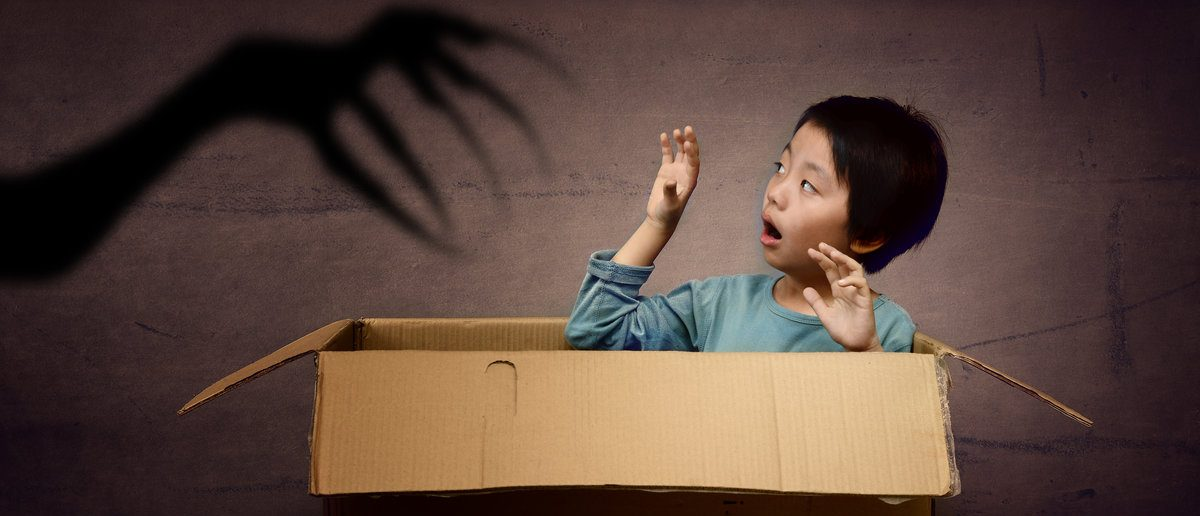 Scared boy in box (Shutterstock/Hung Chung Chih)