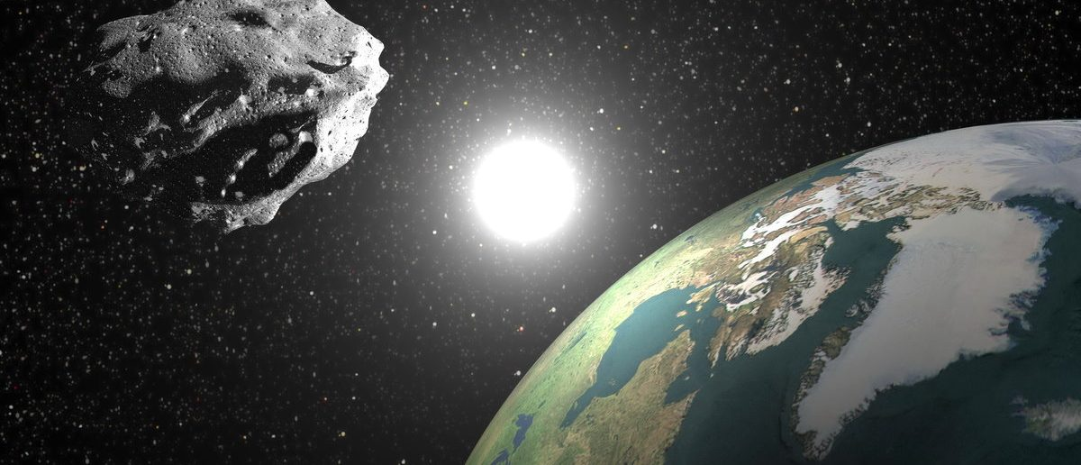 Asteroid nears Earth with sun in the background. Elements of this image furnished by NASA (Shutterstock/Elenarts)
