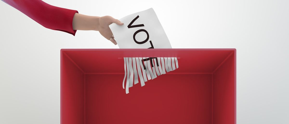 A paper shredder used as a ballot box (Shutterstock/Mopic)