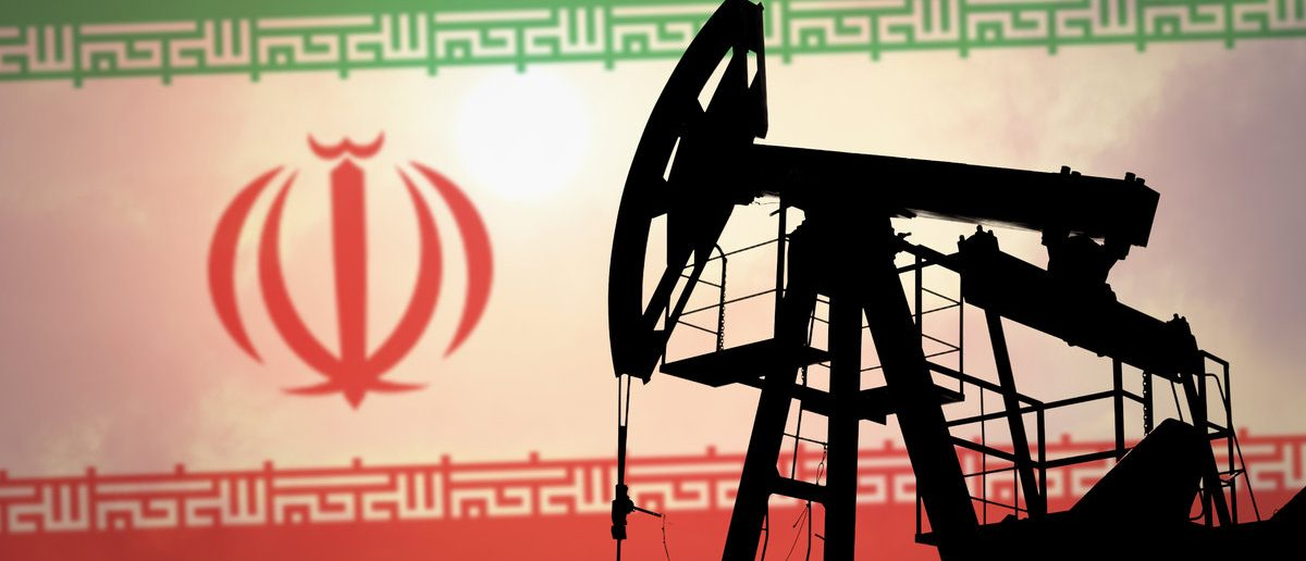 Oil pump on background of flag of Iran (Shutterstock/Anton Watman)