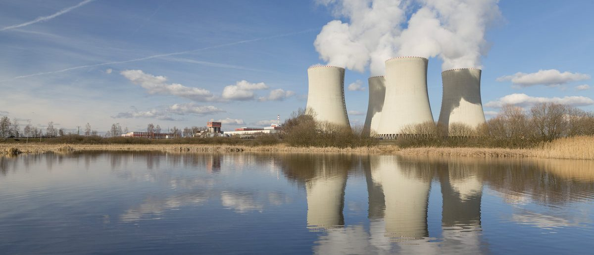 Nuclear power plant reflected in the small lake. (Shutterstock/Nadezda Murmakova)