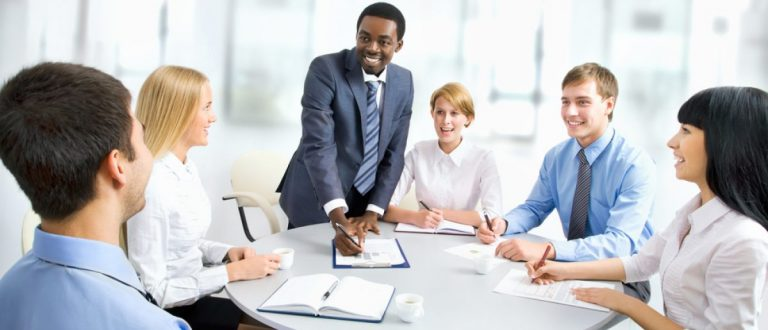 Business people working together as a group to complete a project. [Shutterstock - Konstantin Chagin]
