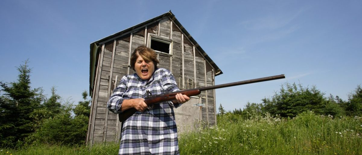 An elderly woman wants trespassers off her property and swings around a rather large shotgun. [Shutterstock - Ronald Sumners -15204280]