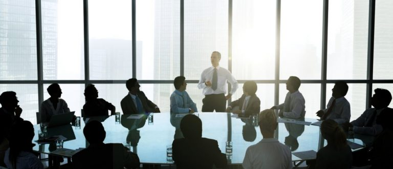 Leader talking to business team at weekly meeting. [Shutterstock - Rawpixel.com - 178721354]