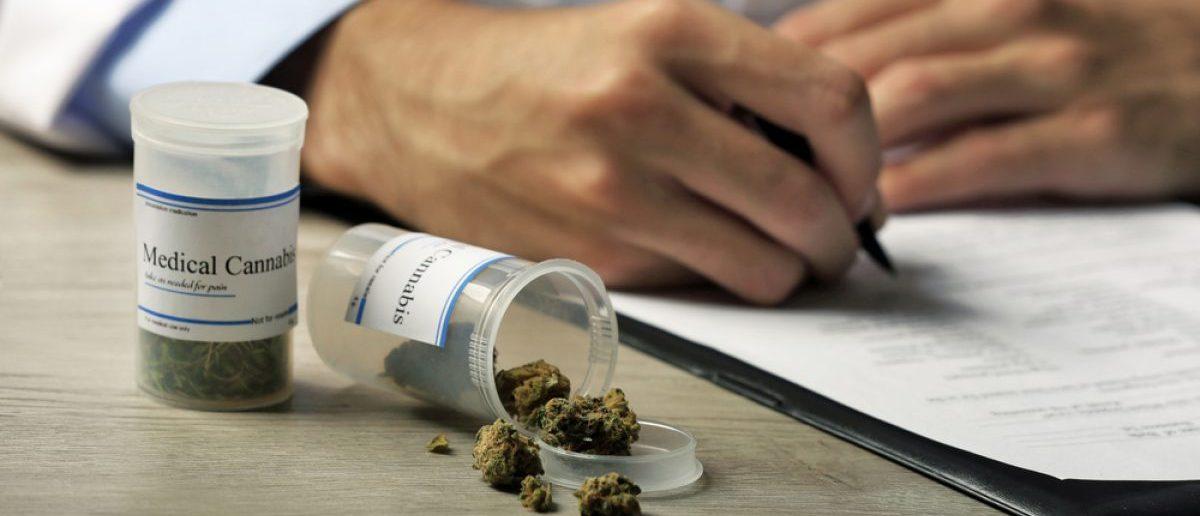 A doctor writing a prescription for medical marijauna.