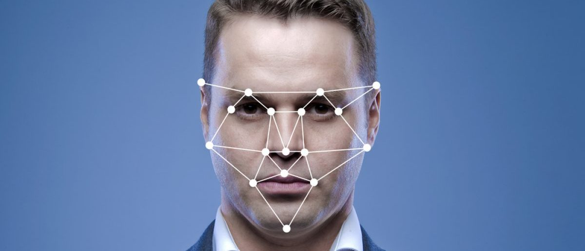 Biometric verification of a young mans face. [Shutterstock - Anton Watman - 331957112]