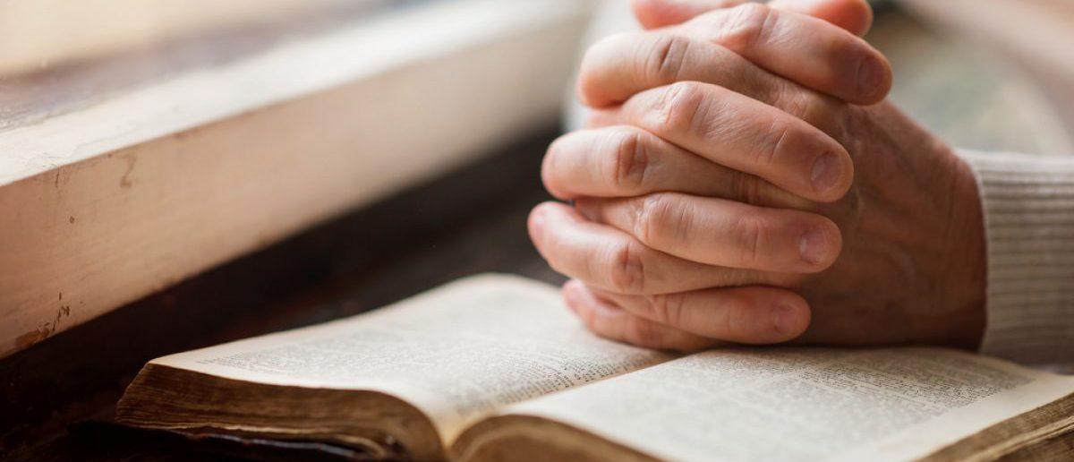 Prayer. [Shutterstock/Halfpoint]