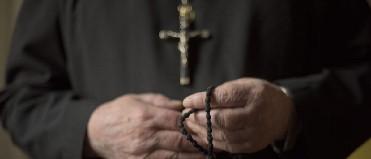 Here are hands of a priest. (Credit: Neville Elder / Shutterstock.com)