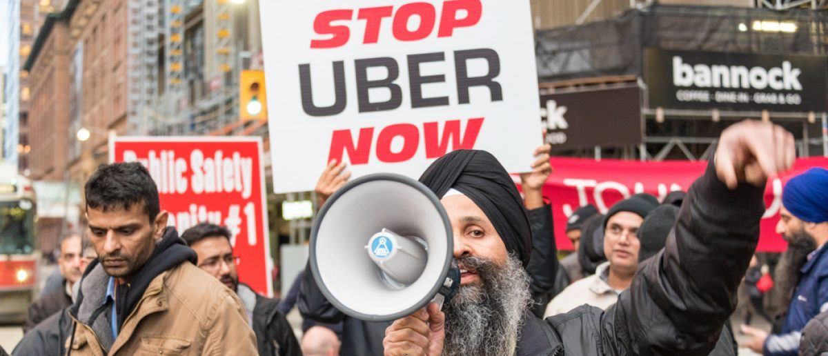 TORONTO, CANADA-DECEMBER 9, 2015: Taxi drivers protest agaist Uber and the city lack of regulation that creates an unfair competition. The protest blocked a main intersection in downtown for hours. [Shutterstock - rmnoa357]