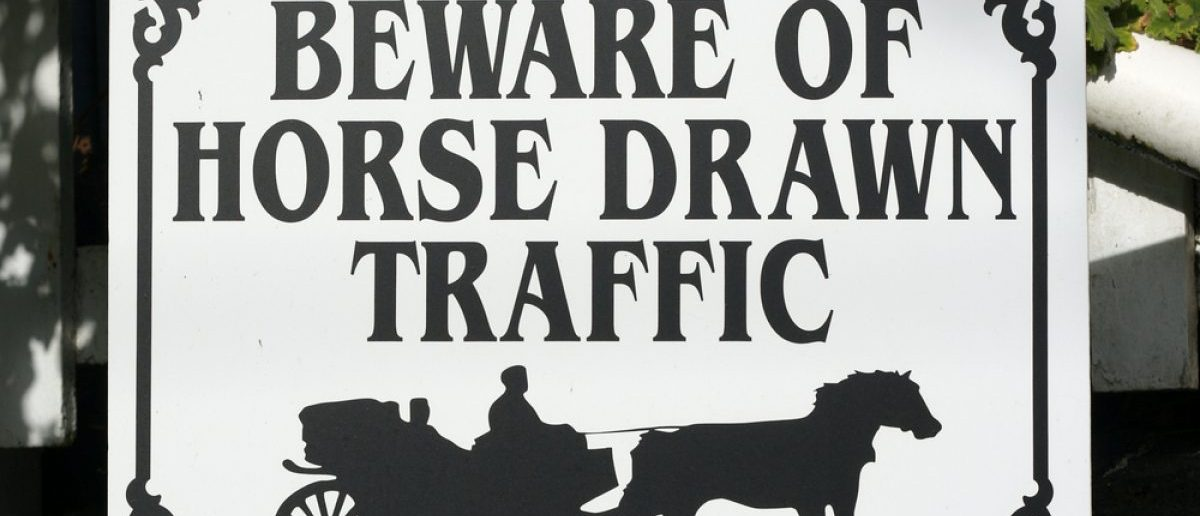 A caution sing for horse-drawn buggy traffic.