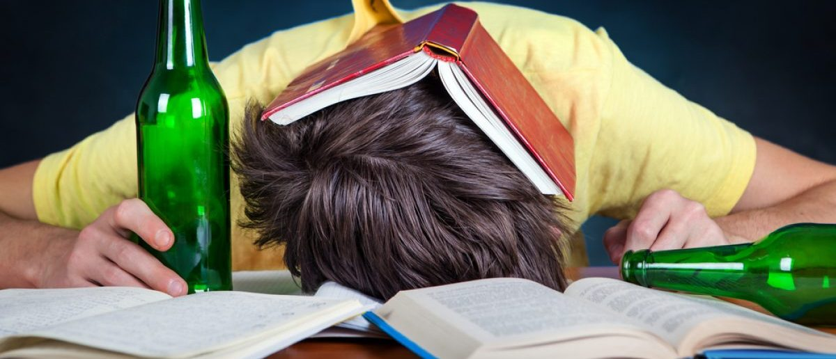 Passed out drunk on books. Shutterstock/Sabphoto