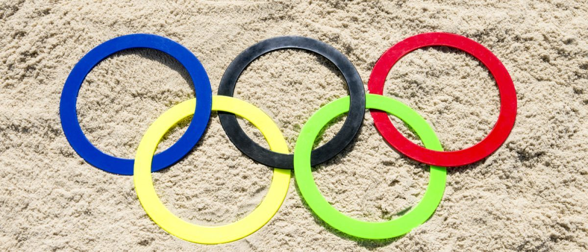 RIO DE JANEIRO - APRIL 4, 2016: Olympic rings rest in the sand on Ipanema Beach in anticipation of the city hosting the 2016 Summer Games. [Shutterstock - lazyllama]