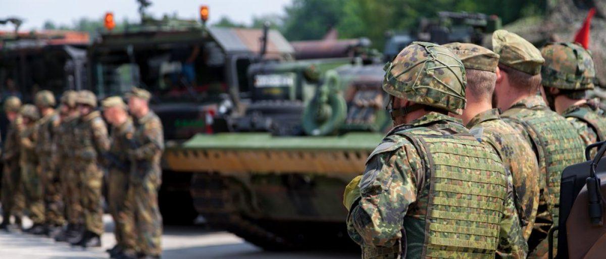German soldiers stands by army convoy .BURG / GERMANY - JUNE 25, 2016. (Credit: Joerg Huettenhoelscher / Shutterstock.com)