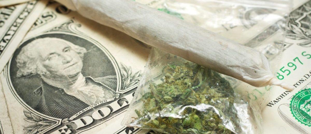 Marijuana and money. Shutterstock/ Stepan Kapl