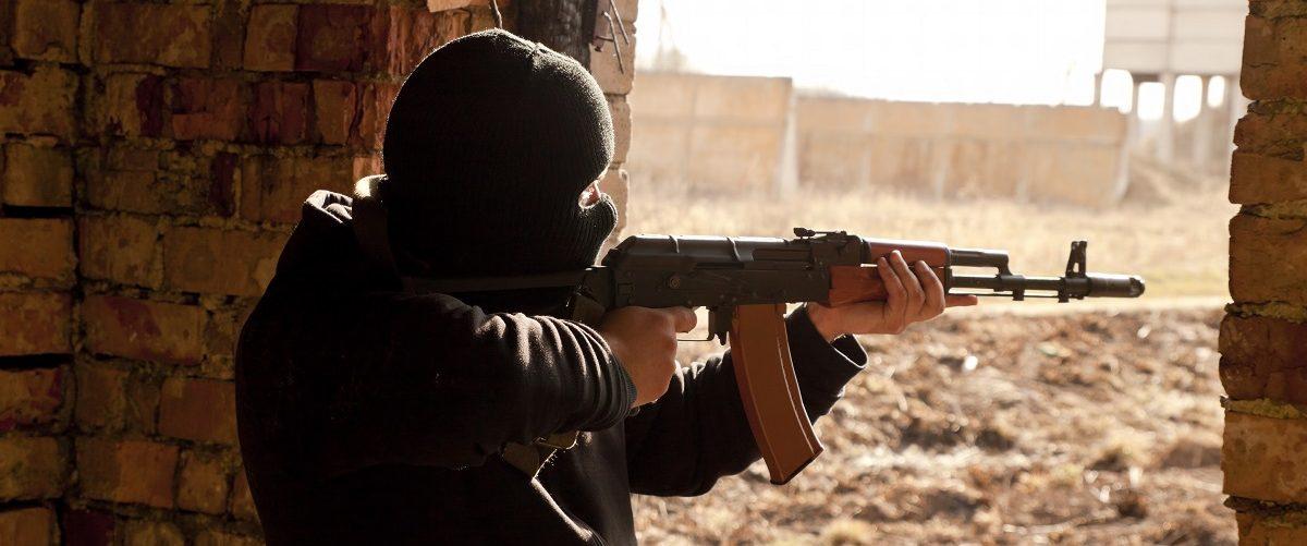 Man In Mask Shoots Gun
