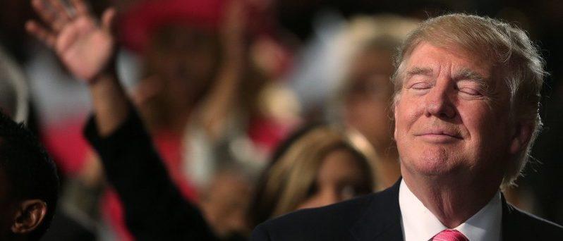 Republican presidential nominee Donald Trump attends a church service, in Detroit, Michigan, U.S., September 3, 2016.   REUTERS/Carlo Allegri