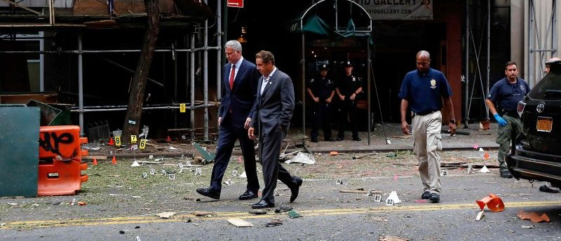 New York Mayor Bill de Blasio (L) and New York Governor Andrew Cuomo (R)  tour the site of an explosion that occurred on Saturday night in the Chelsea neighborhood of New York, USA,September 18, 2016. REUTERS/Justin Lane/Pool