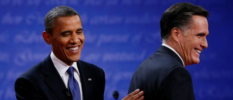President Barack Obama (L) and Republican presidential nominee Mitt Romney share a laugh at the end of the first presidential debate in Denver, U.S., October 3, 2012. REUTERS/Jim Bourg/File Photo