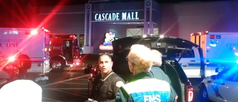 Medics wait to gain access to the Cascade Mall after four people were shot dead in Burlington