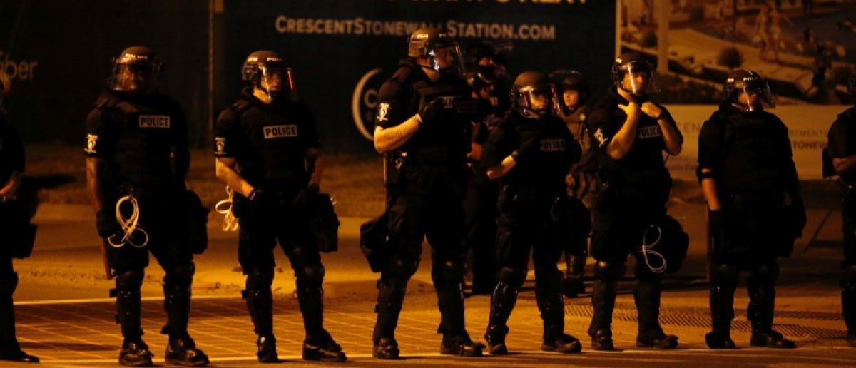 Police monitor marchers protesting the police shooting of Keith Scott in Charlotte, North Carolina, U.S. September 24, 2016. REUTERS/Jason Miczek