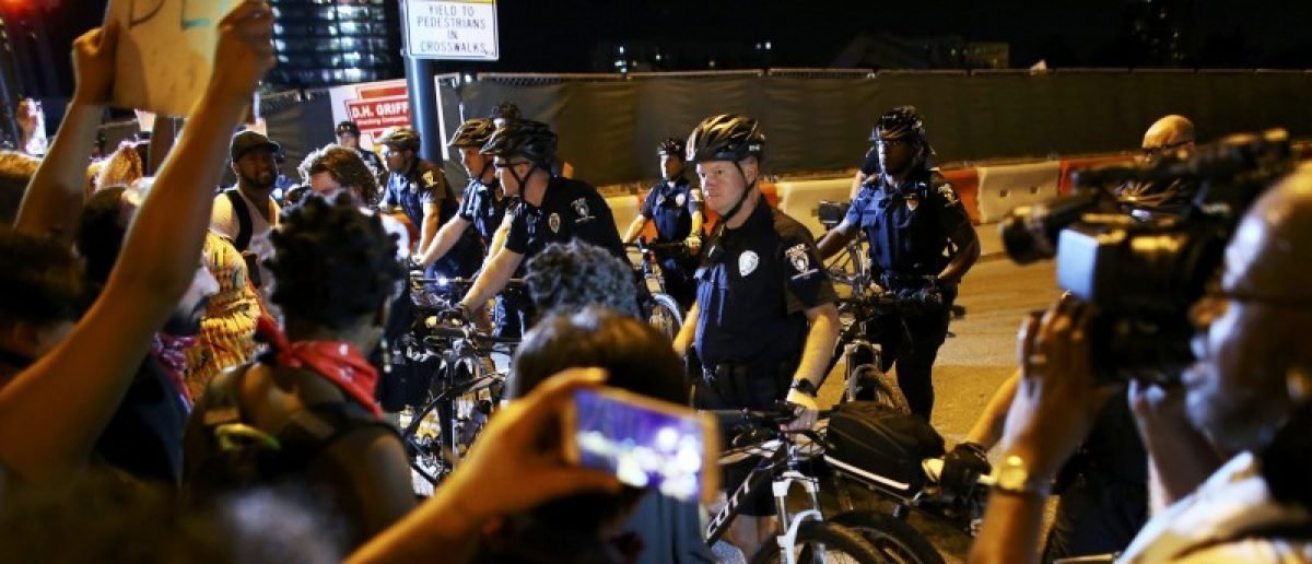 Protesters confront police officers during another night of protests over the police shooting of Keith Scott in Charlotte, North Carolina, U.S. September 24, 2016. REUTERS/Mike Blake