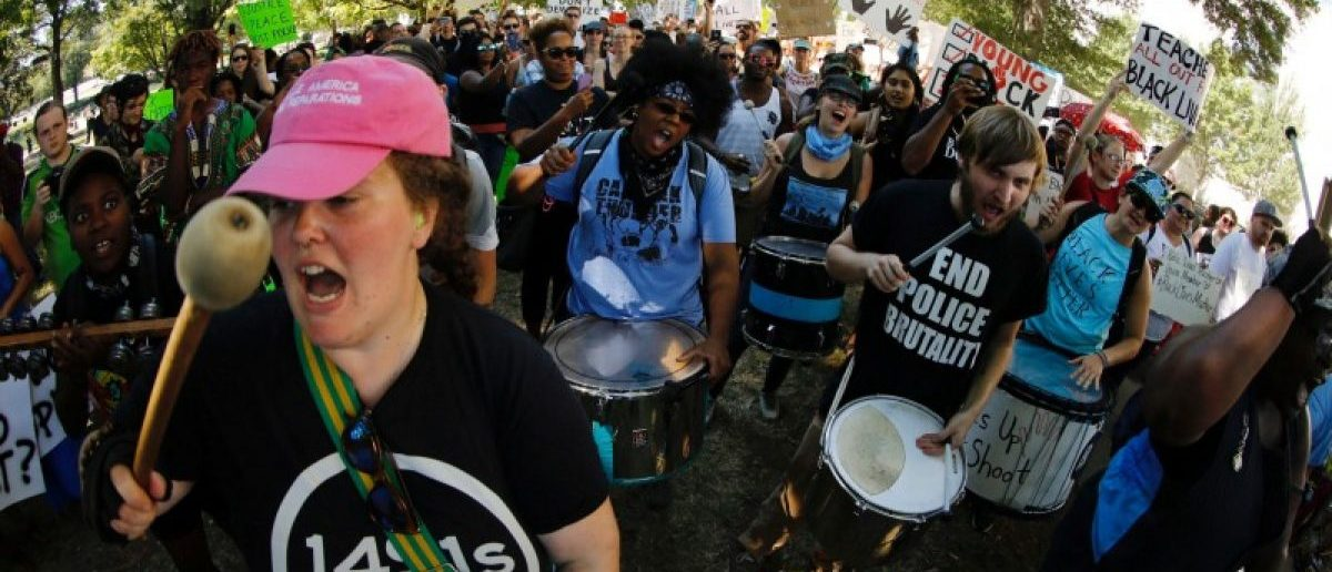 Drummers kick off a march through the city to protest the police shooting of Keith Scott, in Charlotte, North Carolina, U.S., September 24, 2016. REUTERS/Jason Miczek
